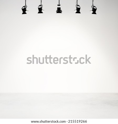 Empty photo studio background with lamps and spotlights - stock photo