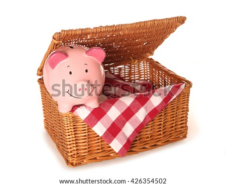empty picnic basket and piggy bank cutout - stock photo