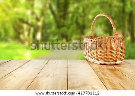 empty picnic basket on yellow wooden table place  - stock photo