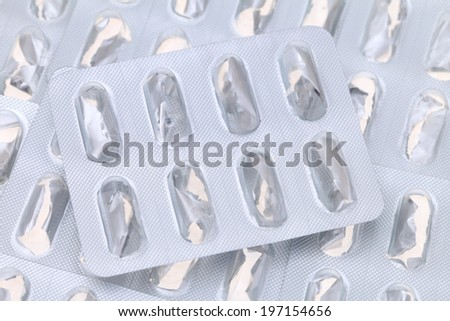 Empty pills package isolated on white background - stock photo