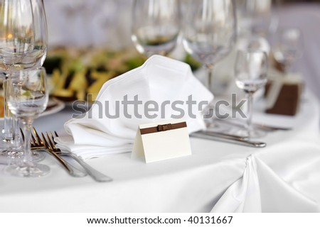 Empty place card on the white festive table