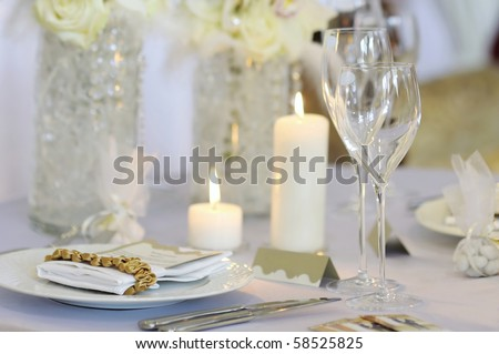 Empty place card on the white festive table - stock photo