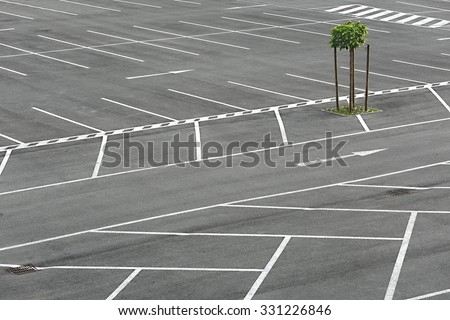 Empty places in a parking lot - stock photo