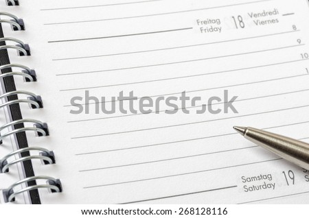 Empty planner with a pen - stock photo