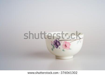empty plastic bowl on white background - stock photo