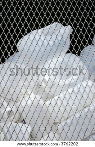 Empty plastic containers waiting in a bin at a recycling center. - stock photo