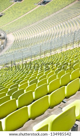 Empty plastic seats at stadium, open door sports arena