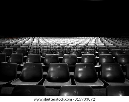 Empty plastic seats at stadium with black and white color - stock photo