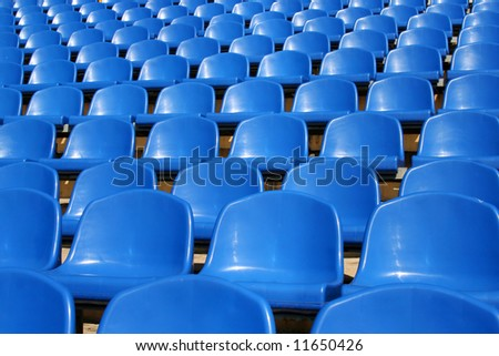 Empty plastic seats in a stadium - stock photo