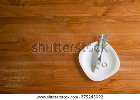 Empty plate after consumption. Symbol expectations. A symbol of of passing. / love