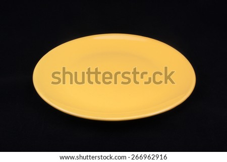 Empty plate. Isolated on black background - stock photo