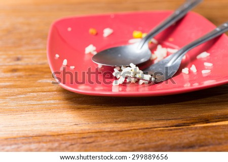 Empty plate left after eating, leftover food - stock photo