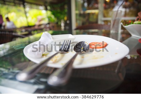Empty plate left on table. - stock photo