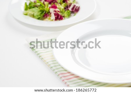 Empty plate on color napkin - stock photo