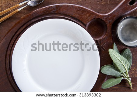empty plate on the board for cutting - stock photo