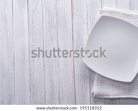 Empty plate  on wooden table - stock photo