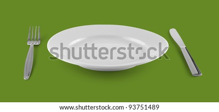empty plate or dish for food with fork and knife on green table - stock photo