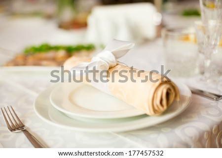 Empty plate set in restaurant - stock photo