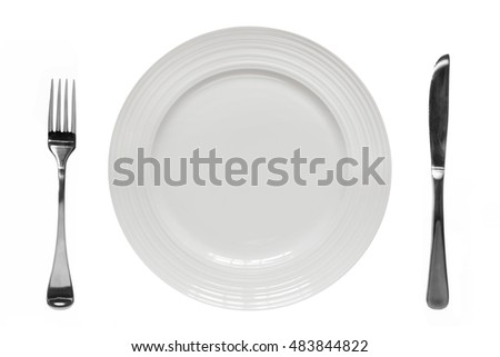 Empty plate with knife and fork.  Top view, isolated on white.