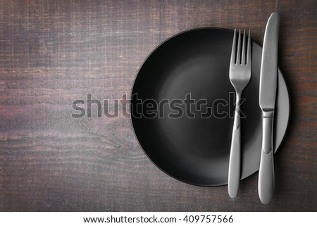 Empty plate with silver cutlery on background - stock photo