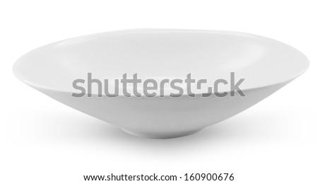 Empty plates on a white background - stock photo