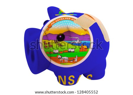 empty poor man piggy rich bank in colors flag of us state of kansas on white - stock photo