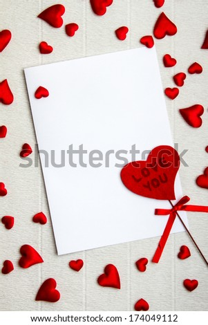 Empty postcard with fabric heart that says Love You and a lot of