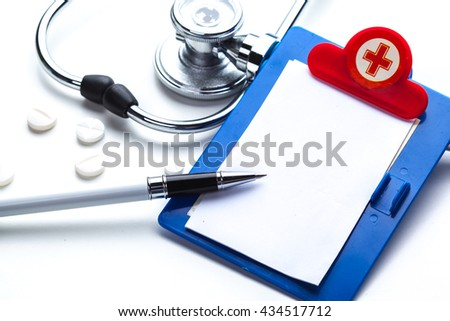 Empty prescription  lying on table with stethoscope - stock photo