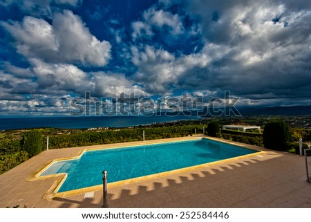 Empty privat pool in front of the sea - stock photo