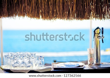 Empty rack bar with sea view - stock photo