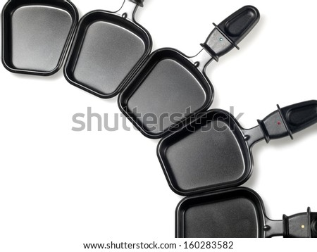 Empty raclette mini pans