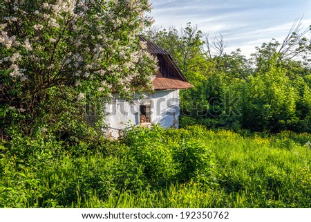 Empty ramshackle dilapidated abandoned old house - stock photo