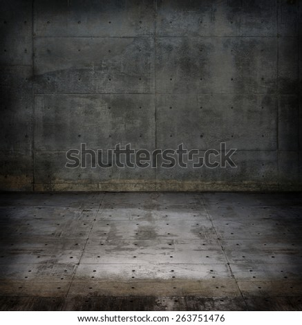 Empty raw concrete space with dim lighting.  - stock photo