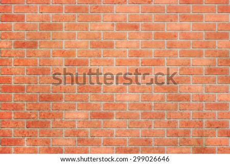 Empty red brick wall textured background. - stock photo