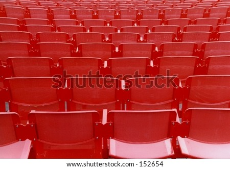 Empty red chairs in Arena concert hall