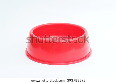 Empty red pet feeder / bowl on isolated white background - stock photo