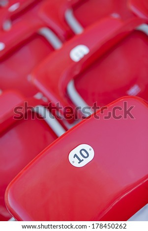empty red seats in rows
