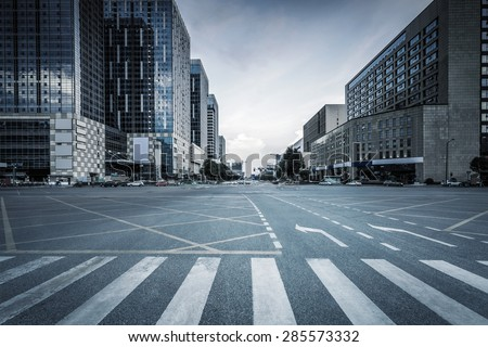 empty road and modern office buildings - stock photo
