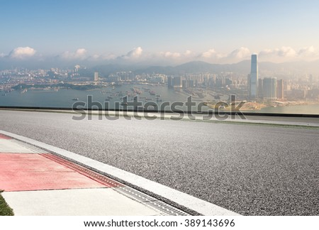 empty road and over view of modern city skyline - stock photo