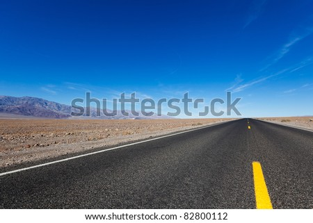 empty road in death valley national park - stock photo