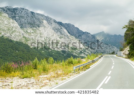 Empty road in the mountains. Road trip. Mountain road - stock photo