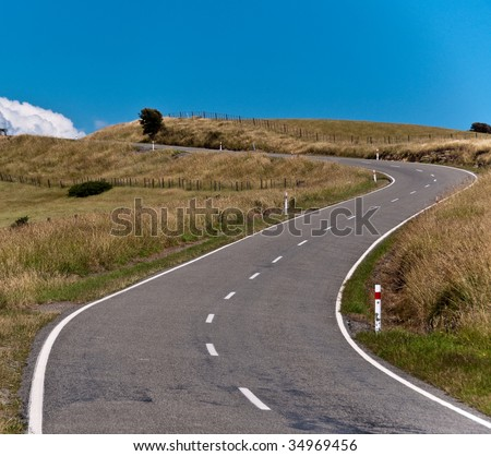Empty road leading into cloud over the horizon - stock photo