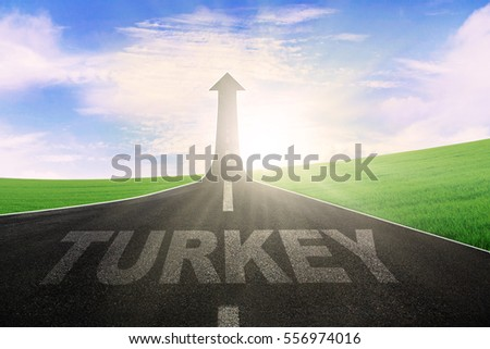 Empty road leading to an arrow upward with a word of Turkey on the street
