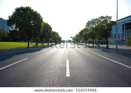 Empty road surface floor with modern buildings backgrounds