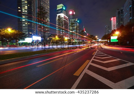 Empty road surface floor with modern city landmark architecture backgrounds of night scene in Shenzhen China - stock photo