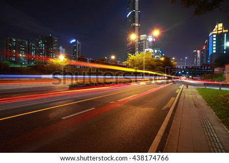 Empty road surface floor with modern city landmark architecture backgrounds of night scene in Shenzhen China