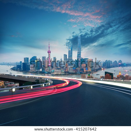 Empty road textured floor with Aerial photography bird-eye view at Shanghai bund Skyline of night scene  - stock photo