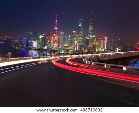 Empty road textured floor with Aerial photography bird-eye view at Shanghai bund Skyline of night scene 
