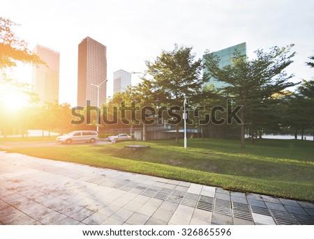 Empty road with modern city skyline - stock photo