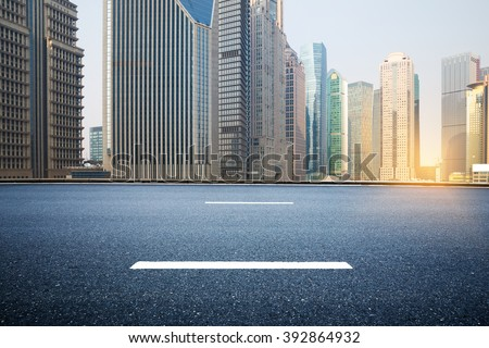 Empty road with Shanghai Bund Lujiazui modern city buildings backgrounds - stock photo